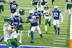 Indianapolis Colts cornerback T.J. Carrie (38) runs in for a touchdown after an interception against the New York Jets in the second half of an NFL football game in Indianapolis, Sunday, Sept. 27, 2020. (AP Photo/AJ Mast)