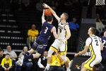Iowa guard Connor McCaffery, center right, blocks a shot by North Florida guard J.T. Escobar (3) during the first half of an NCAA college basketball game, Thursday, Nov. 21, 2019, in Iowa City, Iowa. (AP Photo/Charlie Neibergall)