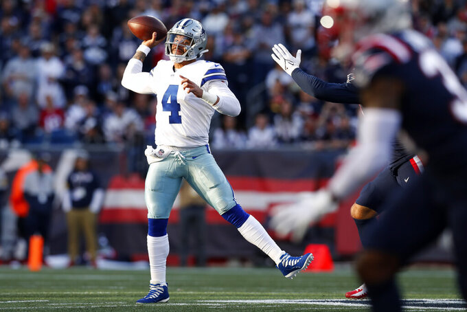 Dallas Cowboys quarterback Dak Prescott (4) throws a pass during the first half of an NFL football game against the New England Patriots, Sunday, Oct. 17, 2021, in Foxborough, Mass. (AP Photo/Michael Dwyer)