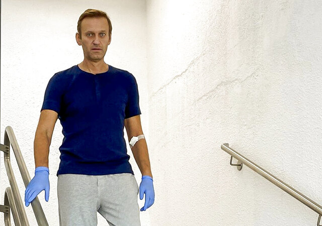 In this photo taken from a video published by Russian opposition leader Alexei Navalny on his instagram account, Russian opposition leader Alexei Navalny walks down stairs in a hospital in Berlin, Germany, Saturday, Sept. 19, 2020. The German hospital treating Russian opposition leader Alexei Navalny for poisoning says his condition improved enough for him to be released from the facility. The Charite hospital in Berlin said Wednesday Sept. 23, 2020 that after 32 days in care, Navalny's condition