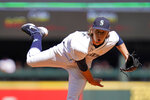 Seattle Mariners starting pitcher Logan Gilbert follows through with a pitch against the Houston Astros in the second inning of a baseball game Wednesday, Sept. 1, 2021, in Seattle. (AP Photo/Elaine Thompson)