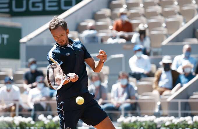 Russia's Daniil Medvedev plays a return to Kazakhstan's Alexander Bublik during their first round match on day two of the French Open tennis tournament at Roland Garros in Paris, France, Monday, May 31, 2021. (AP Photo/Thibault Camus)