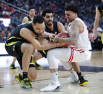 From left, Oregon's Paul White, Ehab Amin and Utah's Timmy Allen scramble during the first half of an NCAA college basketball game in the quarterfinals of the Pac-12 men's tournament Thursday, March 14, 2019, in Las Vegas. (AP Photo/John Locher)