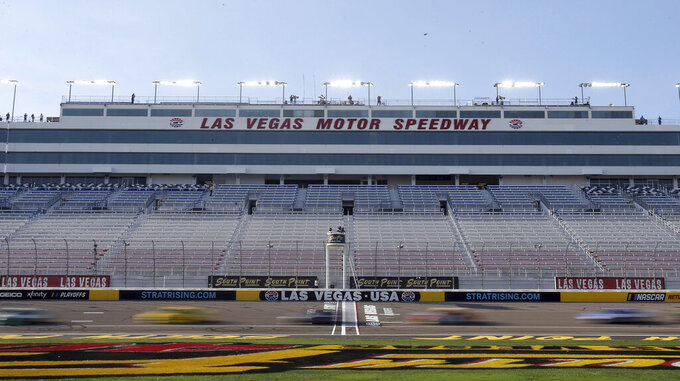 Drivers pass the start finish line during a NASCAR Cup Series auto race Sunday, Sept. 27, 2020, in Las Vegas. The race was run without fans due to COVID-19. (AP Photo/Isaac Brekken)