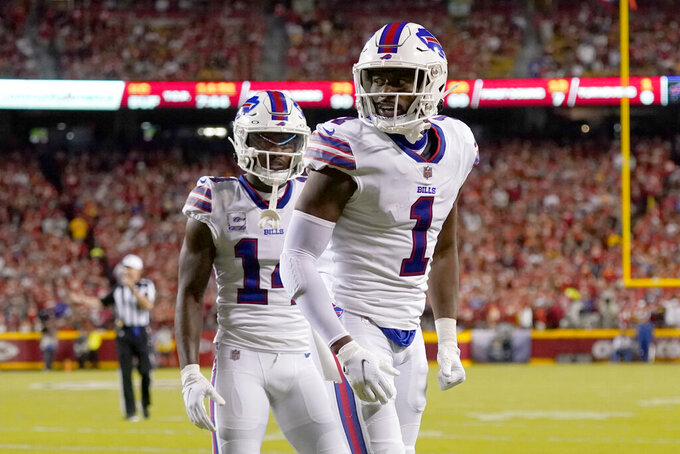 Buffalo Bills wide receiver Emmanuel Sanders (1) is congratulated by Stefon Diggs (14) after scoring during the first half of an NFL football game against the Kansas City Chiefs Sunday, Oct. 10, 2021, in Kansas City, Mo. (AP Photo/Charlie Riedel)