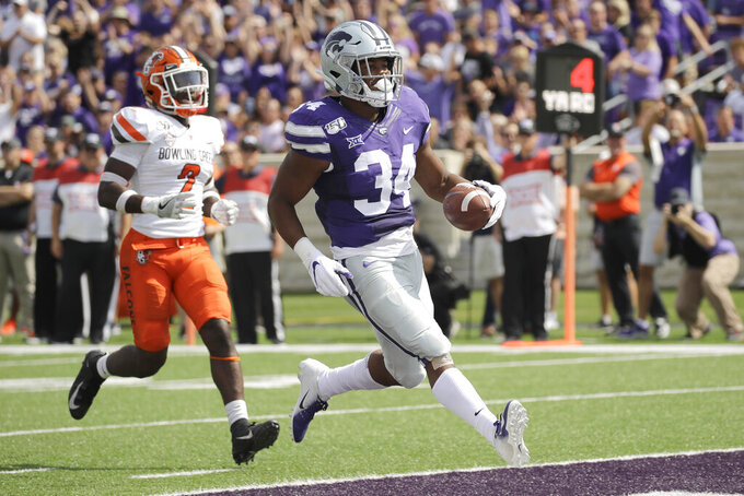 Kansas State running back James Gilbert (34) beats Bowling Green defensive back Caleb Biggers (2) into the end zone to score a touchdown during the first half of an NCAA college football game Saturday, Sept. 7, 2019, in Manhattan, Kan. (AP Photo/Charlie Riedel)