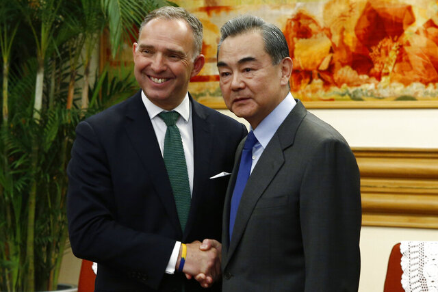 FILE - In this file photo dated Wednesday, May 8, 2019, Britain's National Security Adviser Mark Sedwill shakes hands with Chinese Foreign Minister Wang Yi, right, in Beijing.  Britain's top civil servant Mark Sedwill announced Sunday June 28, 2020, he will resign from his role as Cabinet Secretary, national security adviser and head of the Civil Service in September 2020.  (Florence Lo/Pool FILE via AP)