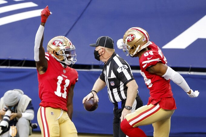 San Francisco 49ers' Brandon Aiyuk (11) celebrates his touchdown catch with Kendrick Bourne (84) in the first half of an NFL football game against the Dallas Cowboys in Arlington, Texas, Sunday, Dec. 20, 2020. (AP Photo/Michael Ainsworth)