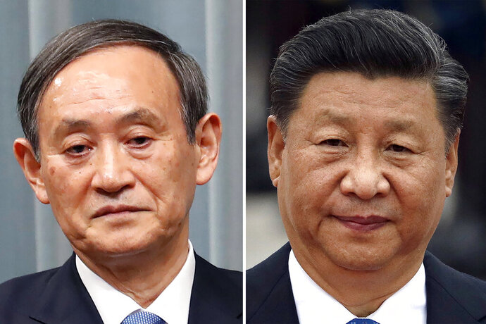 FILE - This combination of file photos show Japan's then Chief Cabinet Secretary Yoshihide Suga, left, in Tokyo on April 1, 2019 and Chinese President Xi Jinping in Beijing on Sept. 11, 2019. New Japanese Prime Minister Yoshihide Suga said he and Chinese President Xi agreed in talks Friday, Sept. 25, 2020 to work closely together by holding high-level meetings including summits, but did not discuss the possibility of a visit by Xi to Japan. (AP Photo/File)