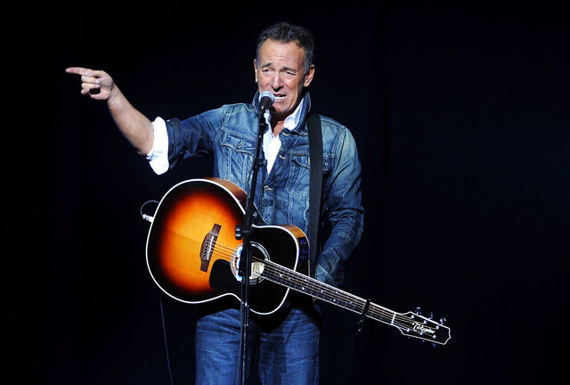 FILE - In this Nov. 5, 2018, file photo, Bruce Springsteen performs at the 12th annual Stand Up For Heroes benefit concert at the Hulu Theater at Madison Square Garden in New York. Iconic artists Lin-Manuel Miranda, Jon Bon Jovi and Bruce Springsteen are among the stars who will highlight a primetime virtual celebration televised Wednesday night following President-elect Joe Biden's inauguration.(Photo by Brad Barket/Invision/AP, File)