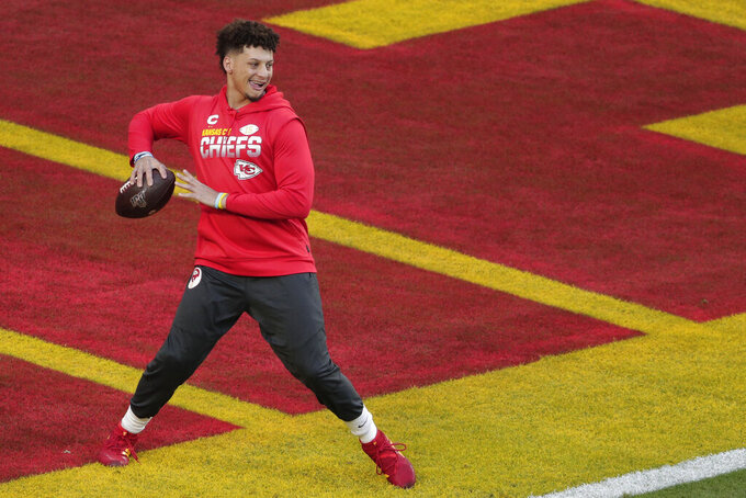 Kansas City Chiefs quarterback Patrick Mahomes warms up before the NFL Super Bowl 54 football game between the San Francisco 49ers and Kansas City Chiefs, Sunday, Feb. 2, 2020, in Miami Gardens, Fla. (AP Photo/Charlie Riedel)