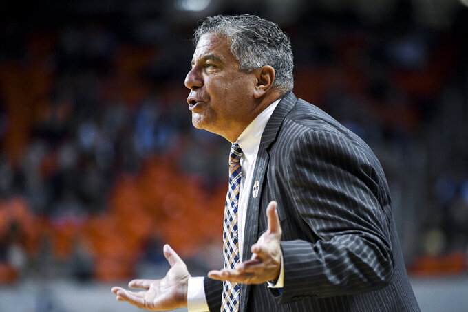 Auburn head coach Bruce Pearl talks to the team during the first half of an NCAA college basketball game against Colgate Monday, Nov. 18, 2019, in Auburn, Ala. (AP Photo/Julie Bennett)