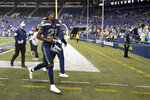 Seattle Seahawks cornerback Tre Flowers fogs off the field after the team's NFL football preseason game against the Los Angeles Chargers, Saturday, Aug. 28, 2021, in Seattle. The Seahawks won 27-0. (AP Photo/Elaine Thompson)