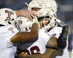 Temple wide receiver Travon Williams (26) is congratulated after scoring his team's seventh touchdown in the second half of an NCAA college football game against Connecticut, Saturday, Nov. 24, 2018, in East Hartford, Conn. (AP Photo/Stephen Dunn)