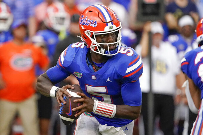 Florida quarterback Emory Jones scrambles as he looks for a receiver against Alabama during the second half of an NCAA college football game, Saturday, Sept. 18, 2021, in Gainesville, Fla. (AP Photo/John Raoux)