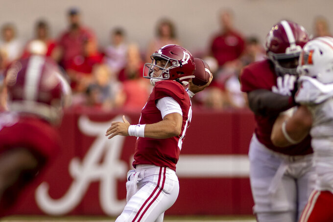 Alabama quarterback Paul Tyson (17) throws a long pass to wide receiver JoJo Earle (10) during the second half of an NCAA college football game against Mercer, Saturday, Sept. 11, 2021, in Tuscaloosa, Ala. (AP Photo/Vasha Hunt)