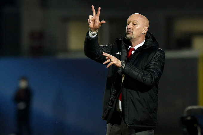 FILE - In this Sunday, March 28, 2021 filer, Hungary coach Marco Rossi looks on during theWorld Cup2022GroupIqualifying soccer match between San Marino andHungary,at the Olympic Stadium in Serravalle, San Marino. (AP Photo/Marco Vasini, File)