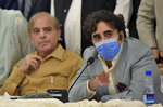 Pakistani opposition parties leaders Bilawal Bhutto Zardari, right, speaks while Shahbaz Sharif looks at a press briefing following their All Parties Conference, in Islamabad, Pakistan, Sunday, Sept. 20. 2020. Pakistani opposition parties demanded immediate resignation of Prime Minister Imran Khan and they launched an alliance to hold a countrywide protest movement against the government. (AP Photo/Anjum Naveed)