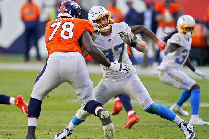 Los Angeles Chargers defensive end Joey Bosa (97) battles Denver Broncos offensive tackle Demar Dotson (78) during the second half of an NFL football game, Sunday, Nov. 1, 2020, in Denver. (AP Photo/David Zalubowski)