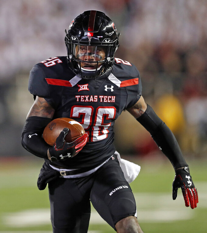 Texas Tech's Ta'Zhawn Henry (26) runs the ball to score a touchdown during the first half of an NCAA college football game against Oklahoma, Saturday, Nov. 3, 2018, in Lubbock, Texas. (AP Photo/Brad Tollefson)
