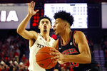 Georgia's Toumani Camara (10) moves the ball past Texas A&M guard Andre Gordon (20)  during an NCAA basketball game in Athens, Ga., on Saturday, Feb. 1, 2020. (Joshua L. Jones/Athens Banner-Herald via AP)
