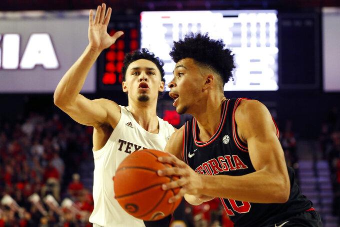 Georgia's Toumani Camara (10) moves the ball past Texas A&M guard Andre Gordon (20)  during an NCAA basketball game in Athens, Ga., on Saturday, Feb. 1, 2020. (Joshua L. Jones/Athens Banner-Herald via AP)