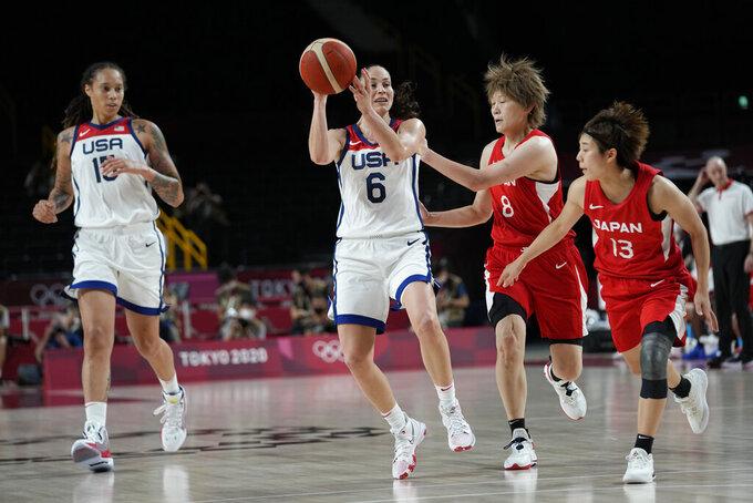 United States' Sue Bird (6) drives past Japan's Maki Takada (8) and Rui Machida (13), right, during women's basketball gold medal game at the 2020 Summer Olympics, Sunday, Aug. 8, 2021, in Saitama, Japan. (AP Photo/Eric Gay)