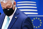 """FILE- In this Saturday, July 18, 2020, file photo, Hungary's Prime Minister Viktor Orban wears a protective face mask as he arrives for a round table meeting at an EU summit in Brussels. Hungary's prime minister says that his country won a """"very important battle"""" at the European Union summit this week, where national leaders of the 27-member bloc decided an seven-year budget and economic recovery package to counter the effects of the coronavirus pandemic. (Francois Lenoir, Pool Photo via AP. File)"""