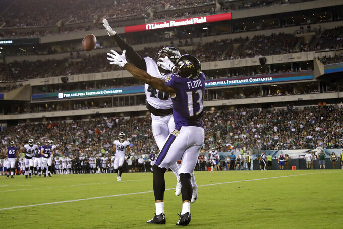 Philadelphia Eagles' Josh Hawkins, left, breaks up a pass intended for Baltimore Ravens' Michael Floyd in the end zone during the first half of a preseason NFL football game Thursday, Aug. 22, 2019, in Philadelphia. (AP Photo/Matt Rourke)