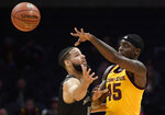 Arizona State forward Zylan Cheatham, right, passes the ball while under pressure from Nevada forward Caleb Martin during the first half of an NCAA college basketball game at the Basketball Hall of Fame on Classic Friday, Dec. 7, 2018, in Los Angeles. (AP Photo/Mark J. Terrill)