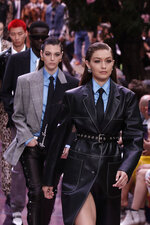 Model Gigi Hadid wears a creation as part of the Versace men's Spring-Summer 2020 collection, unveiled during the fashion week, in Milan, Italy, Saturday, June 15, 2019. (AP Photo/Luca Bruno)