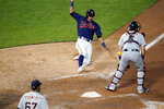 Minnesota Twins' Ehire Adrianza, top left, slides in to score and tie a baseball game on a Miguel Sano hit off Detroit Tigers pitcher Jose Cisnero, lower left, in the ninth inning Saturday, Sept. 5, 2020, in Minneapolis. (AP Photo/Jim Mone)