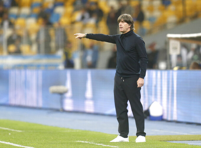 Germany's Joachim Low stands on the touchline during the UEFA Nations League soccer match between Ukraine and Germany at the Olimpiyskiy Stadium in Kyiv, Ukraine, Saturday, Oct.10, 2020. (AP Photo/Efrem Lukatsky)