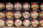 A portion of Bob and Susan Hope's baseball collection is seen with price stickers attached, Friday, Aug. 23, 2019, in Stone Mountain, Ga. Susan died about two years ago, leaving behind the collection to her surviving husband. (AP Photo/Andrea Smith)