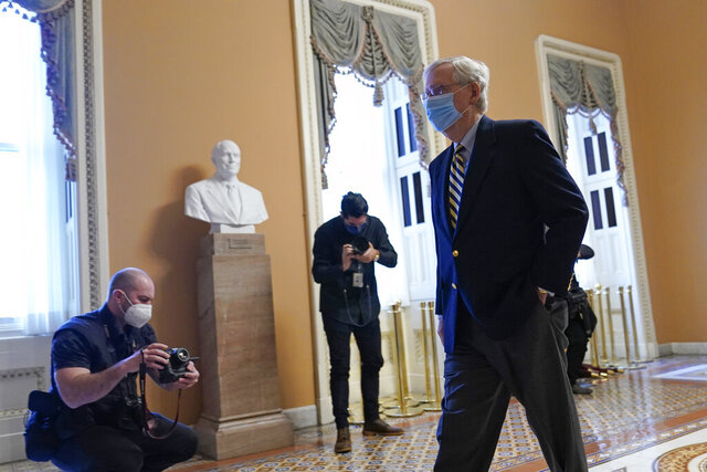 Senate Minority Leader Mitch McConnell of Ky., walks to his office on Capitol Hill in Washington, Monday, Jan. 25, 2021. (AP Photo/Susan Walsh)