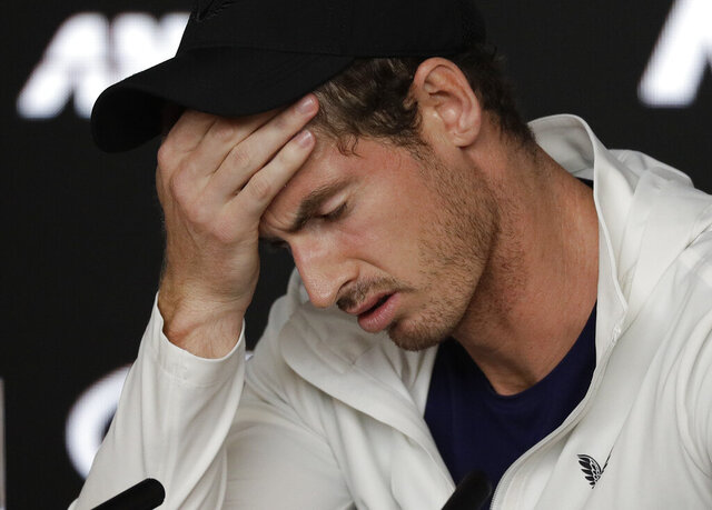 FILE - In this Tuesday, Jan. 15, 2019 file photo Britain's Andy Murray reacts during a press conference following his first round loss to Spain's Roberto Bautista Agut at the Australian Open tennis championships in Melbourne, Australia. Former world number one Murray's participation at the upcoming Australian Open is in doubt after the Briton tested positive for COVID-19. (AP Photo/Kin Cheung, File)