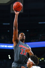 Louisville center Steven Enoch (23) goes up for the shot during the second half of an NCAA college basketball game against Georgia Tech in Atlanta, Wednesday, Feb. 12, 2020. (AP Photo/Todd Kirkland)