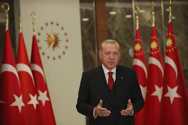 Turkey's President Recep Tayyip Erdogan, stands during an event to mark Turkey's National Sovereignty and Children's Day, in Istanbul, Thursday, April 23, 2020. Turkey celebrates National Sovereignty and Children's Day on the 100th anniversary of the foundation of Turkey's parliament and Turks are marking their first national holiday under lockdown amid the new coronavirus pandemic. (Turkish Presidency via AP, Pool)