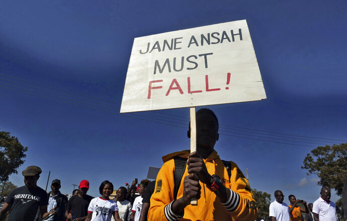 A protester carries a placard calling for the ouster of Malawi Electoral Commission chairwoman, Jane Ansah, during a protest in Lilongwe, Malawi Thursday June 20, 2019. Police in Malawi have fired tear gas at some protesters as thousands demonstrate in major cities over last month's disputed election. (AP Photo)