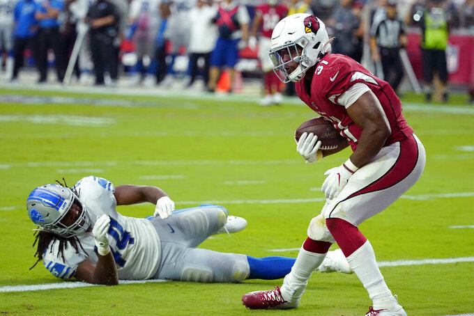 Arizona Cardinals running back David Johnson (31) pulls in a touchdown pass as Detroit Lions linebacker Jalen Reeves-Maybin (44) defends during the second half of an NFL football game, Sunday, Sept. 8, 2019, in Glendale, Ariz. (AP Photo/Rick Scuteri)