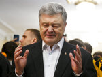 Ukrainian President Petro Poroshenko gestures while speaking to the media at a polling station, during the second round of presidential elections in Kiev, Ukraine, Sunday, April 21, 2019. Top issues in the election have been corruption, the economy and how to end the conflict with Russia-backed rebels in eastern Ukraine. (AP Photo/Efrem Lukatsky)