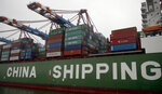 """Containers are pictured on board of the 'Star' vessel of the China Shipping Container Lines shipping company at the harbour in Hamburg, Germany, Wednesday, Oct. 29, 2014. Germany's Chancellor Angela Merkel wants to preserve trade and cooperation on global warming but has warned of possible consequences if the security law that will tighten Beijing's control over Hong Kong goes ahead. """"China is an important partner for us but also a competitor,"""" said Foreign Minister Heiko Maas in a statement on Friday, July 24, 2020, after a videoconference  with his Chinese counterpart, Wang Yi. (AP Photo/Michael Sohn, File)"""