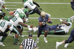 Navy fullback Jamale Carothers (34) runs through the Tulane defense while scoring ona run during the first half of an NCAA college football game, Saturday, Oct. 26, 2019, in Annapolis. (AP Photo/Julio Cortez)
