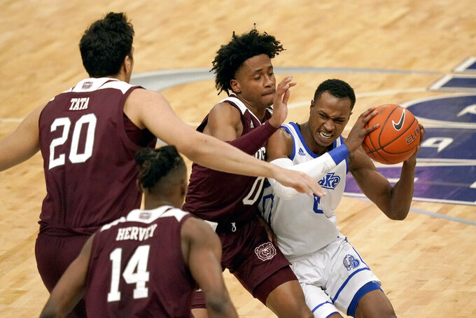 Drake's D.J. Wilkins, right, heads to the basket past Missouri State's Demarcus Sharp, Nic Tata (20) and Keaton Hervey (14) during the first half of an NCAA college basketball game in the semifinal round of the Missouri Valley Conference men's tournament Saturday, March 6, 2021, in St. Louis. (AP Photo/Jeff Roberson)
