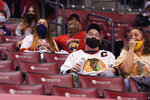 Fans watch the second period of an NHL hockey game between the Florida Panthers and the Chicago Blackhawks on Tuesday, Jan. 19, 2021, in Sunrise, Fla. Not only are the Panthers still unbeaten after two games but they're also leading the NHL in attendance. (AP Photo/Marta Lavandier)