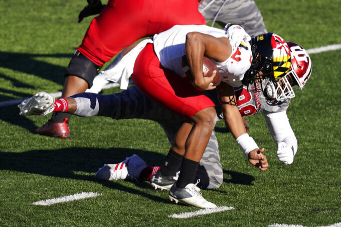 Maryland quarterback Taulia Tagovailoa (3) is sacked by Indiana's Jerome Johnson (98) during the second half of an NCAA college football game, Saturday, Nov. 28, 2020, in Bloomington, Ind. Indiana won 27-11. (AP Photo/Darron Cummings)