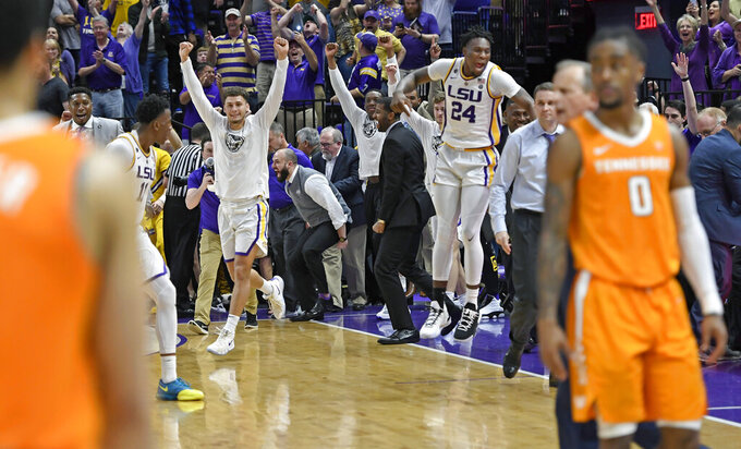 The LSU bench erupts as Tennessee player walk off the floor as time runs out in overtime of an NCAA college basketball game, Saturday, Feb. 23, 2019, in Baton Rouge, La. LSU won in overtime 82-80 in overtime. (AP Photo/Bill Feig)