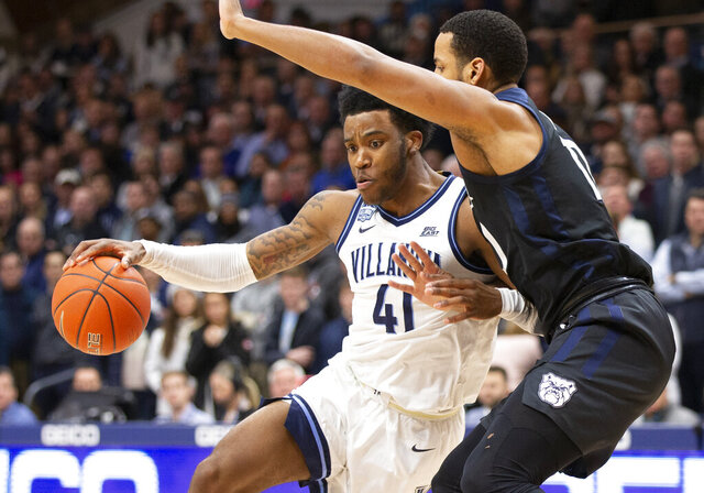 Villanova forward Saddiq Bey (41) moves around Butler forward Bryce Nze (10) during the first half of an NCAA college basketball game, Tuesday, Jan. 21, 2020, in Villanova, Pa. (AP Photo/Laurence Kesterson)