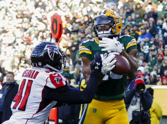 FILE - In this Dec. 9, 2018, file photo, Green Bay Packers' Randall Cobb catches a touchdown pass in front of Atlanta Falcons' Sharrod Neasman during the second half of an NFL football game in Green Bay, Wis. The Dallas Cowboys have agreed to terms on a one-year contract with free-agent receiver Cobb. He spent the first eight years of his NFL career with the Packers. (AP Photo/Jeffrey Phelps, File)