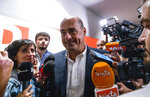 Leader of the Democratic Party, Nicola Zingaretti, meets the media upon leaving the party's headquarters in Rome, Monday, Sept. 2, 2019.  Premier-designate Giuseppe Conte says he is aiming to form Italy's new government by Wednesday. The populist 5-Star Movement is negotiating with the center-left Democratic Party to put their animosity as adversaries aside to avoid an early election that could put the right-wing League in power and make party leader Matteo Salvini premier. (Angelo Carconi/ANSA via AP)